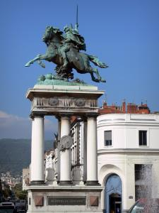 Clermont-Ferrand - Equestrian statue of Vercingetorix located on the Jaude sqaure, fountain and houses