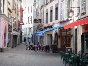 Clermont-Ferrand - Street of the old city with café terraces and building facades
