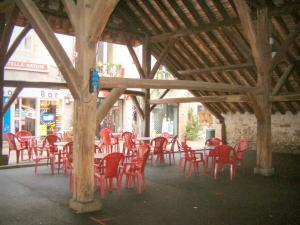 Clisson - Café terrace under covered market hall