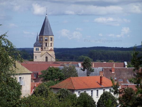 Cluny - The Eau Bénite bell tower and the Clock tower dominating the roofs of the city, forest in background