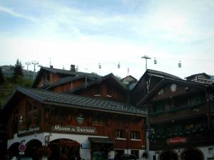 La Clusaz - Wooden chalets of the village (winter and summer sports resort) and cable car (ski lift)