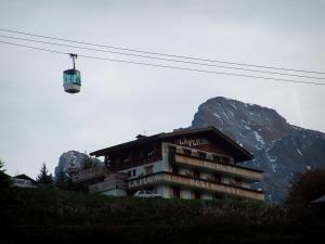 La Clusaz - Cable car (ski lift), chalet and mountain of the Aravis massif