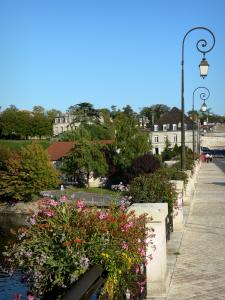 Cognac - Bridge featuring flowers and lampposts, Charente river and houses of the city