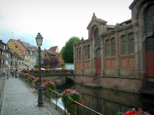 Colmar - Petite Venise (Little Venice): Poissonnerie quayside decorated with flowers, colourful half-timbered houses, covered market hall, small flower-covered bridge and the River Lauch