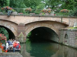 Colmar - Petite Venise (Little Venice): small flower-covered bridge spanning the River Lauch and boat stroll on the canal