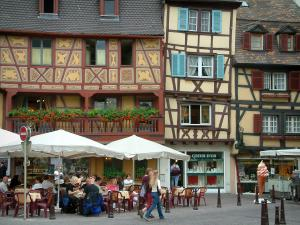 Colmar - Timber-framed houses, a café terrace and shops