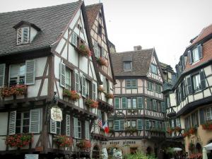 Colmar - Half-timbered houses decorated with geranium flowers