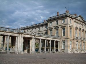Compiègne - Colonnade of the château with a cloudy sky