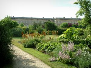 Compiègne - Château garden (park) with plants, flowers, trees and shrubs, château facade in background