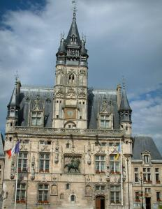 Compiègne - Town hall (building of Flamboyant Gothic style) and its belfry with a cloudy sky