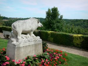 Conches-en-Ouche - Flower garden, statue of a boar, with a view of the Rouloir valley