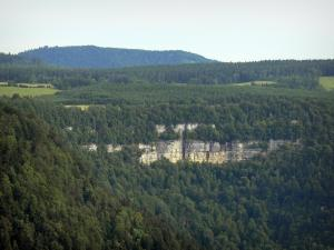 Consolation rock formations - Rock faces (cliffs) and forest (trees)