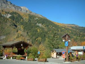 Les Contamines-Montjoie - Place of the village (ski resort) and the forest in autumn
