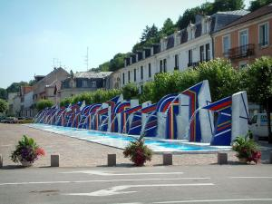 Contrexéville - Square with Carrara marble fountains, trees and houses of the spa town