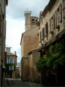 Cordes-sur-Ciel - Narrow street in the medieval town, stone houses and the Saint-Michel church