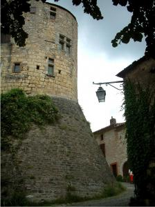 Cordes-sur-Ciel - Tower in the medieval town, lamppost and stone house