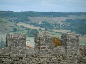 Cordes-sur-Ciel - Ramparts (fortifications) with view of fields, trees and forest