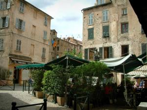 Corte - Gaffori square with the bronze statue and the house of general Gaffori, a café terrace