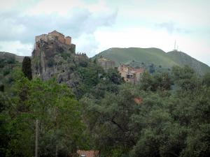Corte - Trees, eyrie of the citadel, houses and a mountain
