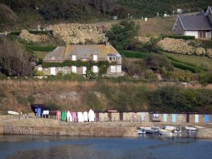 Cotentin coast - Caps road: houses overhanging the Channel (sea), moored boats; landscape of the Cotentin peninsula