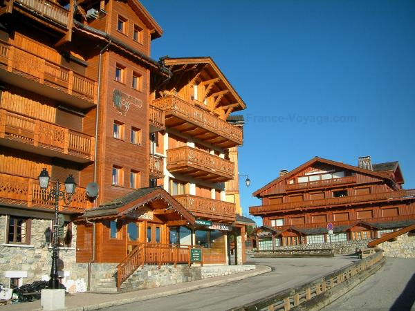 Courchevel - Street and wooden residences - chalets of the Courchevel 1850 ski resort (winter sports)