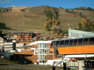 Courchevel - Chairlift (ski lift), chalets, residences and ski area of the ski resort (winter sports)