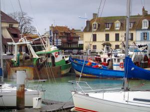 Courseulles-sur-Mer - Port with its boats and its moored trawlers, and houses of the seaside resort