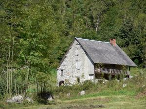 Couserans - Stone house surrounded by trees; in the Ariège Pyrenees Regional Nature Park