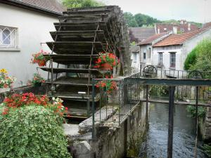 Crécy-la-Chapelle - Grand Morin valley (valley of the Grand Morin painters): wheel of an old mill, geraniums (flowers), River Grand Morin and houses of the village