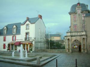 Le Croisic - Aiguillon mansion home to the town hall, square decorated with fountains, houses and turbulent sky