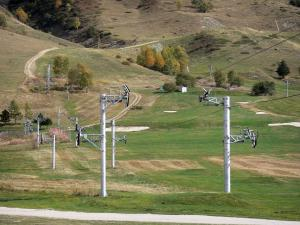Les Deux Alpes - Grassland and chair lift of the ski resort of Les 2 Alpes in autumn