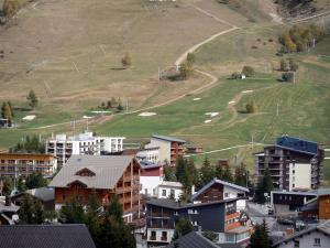 Les Deux Alpes - Ski resort of Les 2 Alpes: chalets, buildings and ski lifts in autumn