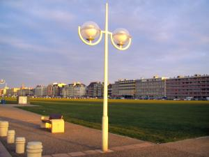Dieppe - Lamppost, bench, lawn and buildings of the city