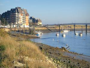 Dives estuary - The River Dives with boats, bridge and residences of the Cabourg seaside resort