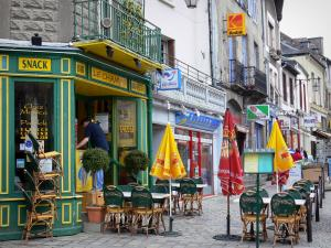 Dol-de-Bretagne - Houses, café terrace and shop signs in the city
