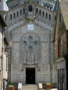Domfront - Facade of the Saint-Julien church of Neo-Byzantine style and medieval houses