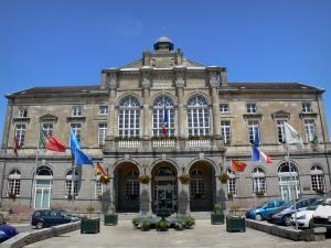 Domfront - Facade of the Town Hall in Domfront, flags and fountain