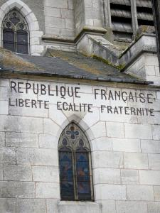 Donzy - Republican motto on the facade of the Saint-Caradeuc church