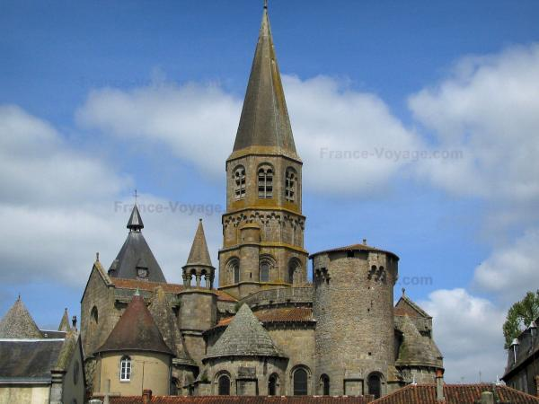 Le Dorat collegiate church - Saint-Pierre granite collegiate church of Romanesque style in Basse-Marche, and clouds in the sky