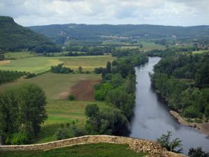 Dordogne valley - The River Dordogne, trees, fields, forests and hills with a cloudy sky, in Périgord
