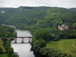 Dordogne valley - Bridge spanning the River Dordogne, trees along the water, Fayrac castle and forest, in Périgord