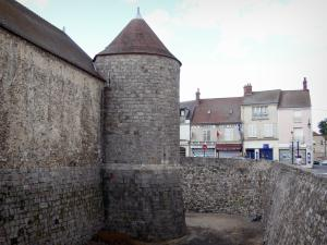 Dourdan - Tower and moats of the feudal castle, facades of houses in the medieval town in the background