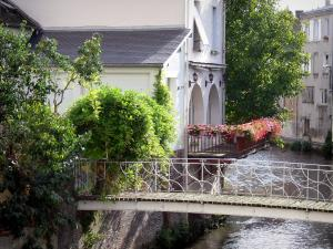 Dreux - Bridge spanning the River Blaise, houses along the water, geranium-bedecked balcony (flowers)