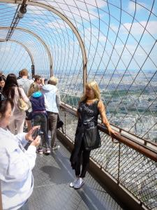 Eiffel tower - Visitors enjoying the view at the top of the Eiffel tower