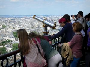 Eiffel tower - Visitors on the second floor admiring the view over Paris