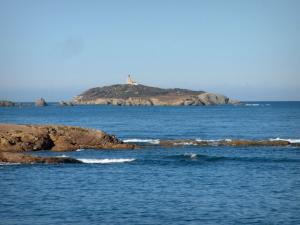 Embiez islands - The Grand Rouveau island with its lighthouse, reefs and the Mediterranean Sea