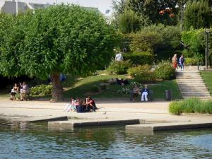 Enghien-les-Bains - Spa town: rose garden with rosebushes, trees and benches along the Enghien lake