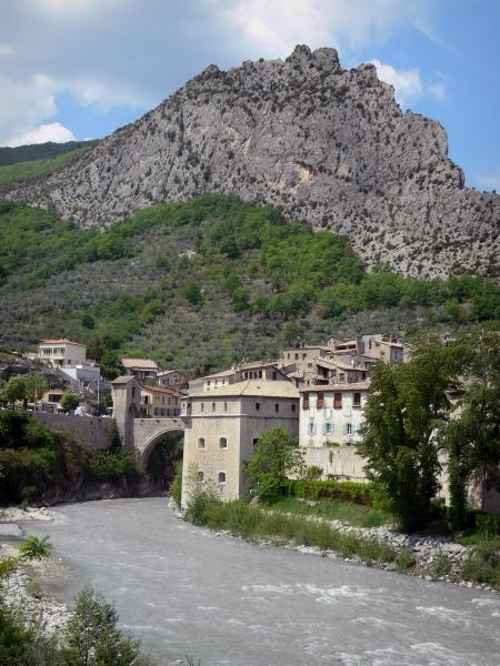 Entrevaux - Houses of the medieval village, Var river and cliff (rock face)