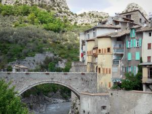Entrevaux - Bridge of the Royale door spanning the Var river and houses of the medieval village