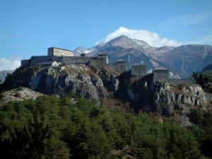 Esseillon forts - Forest, Esseillon barrier and its five fortifications, mountains in background, in Maurienne (peripheral zone of the Vanoise national park and Grande Alpes (Alps) road)